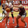 Perry's Braylee Dale knocks the ball away from Kingfisher's Ally Stephenson during the championship game of the Wheat Capital Tournament Saturday, January 9, 2021 at Chisholm High School. (Billy Hefton / Endi News & Eagle)