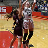 Kingfisher's Peyton Walker shoots over Perry's Josey West during the championship game of the Wheat Capital Tournament Saturday, January 9, 2021 at Chisholm High School. (Billy Hefton / Endi News & Eagle)