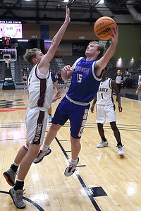 Waukomis' Thad Terrel shoots over Garber's David Nagel during the championship game of the 97th Skeltur Conference Basketball Tournament Saturday, January 23, 2021 at the Stride Bank Center. (Billy Hefton / Enid News & Eagle)