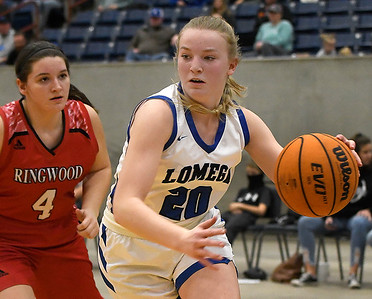 Lomega's Darcy Roberts drives pass Ringwood's Kyanne Randolph during a semi-final gmae of the Cherokee Strip Conference Tournament Friday, January 22, 2021 at the Chisholm Trail Expo Center. (Billy Hefton / Enid News & Eagle)