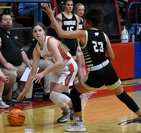 Chisholm's Gracie Holder looks for an opening against Woodward's Averi Edwards during the first round of the Wheat Capital Tournament Thursday, January 7, 2021 at Chisholm High School. (Billy Hefton / Enid News & Eagle)