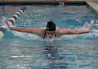 Enid's Elsa Stewart swims the butterfly during practice Monday, January 18, 2021 at the Denny Price Family YMCA. (Billy Hefton / Enid News & Eagle)