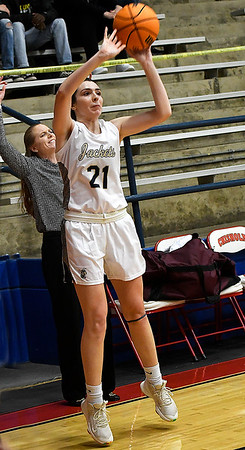 Kingfisher's Allison Green shoots a three point shot to the dismay of Garber coach, Jamie Davis, during the semi finals of the Wheat Capital Tournament Friday, January 8, 2021 at Chisholm High School. (Billy Hefton / Enid News & Eagle)