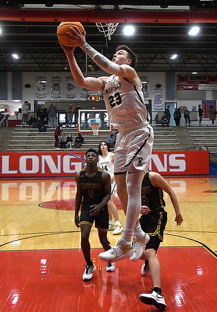 Kingfisher's Matthew Stone scores against Tecumseh during the semi finals of the Wheat Capital Tournament Friday, January 8, 2021 at Chisholm High School. (Billy Hefton / Enid News & Eagle)