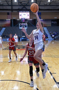 Drummond's Brinley Buchanan gets behind Dover's Katelyn Harviston for a fast break basket during the opening round of the 97th Skeltur Conference Basketball Tournament Thursday, January 21, 2021 at the Stride Bank Center. (Billy Hefton / Endi News & Eagle)