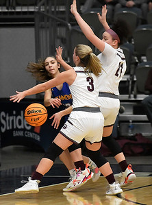 Drummond's Kirya Mack passes the ball while been pressured by Garber's Kathryn Plunkett and Sierra Martin during the championship game of the 97th Skeltur Conference Basketball Tournament Saturday, January 23, 2021 at the Stride Bank Center. (Billy Hefton / Enid News & Eagle)