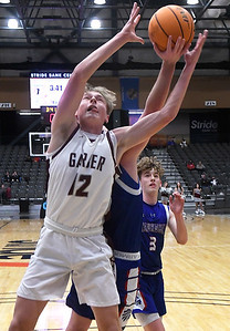 Garber's David Nagel grabs for a rebound with Waukomis' Thad Terrel during the championship game of the 97th Skeltur Conference Basketball Tournament Saturday, January 23, 2021 at the Stride Bank Center. (Billy Hefton / Enid News & Eagle)