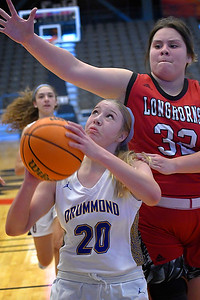 Drummond's Kate Spring puts up a shot as Dover's Yarell Obeso defends during the opening round of the 97th Skeltur Conference Basketball Tournament Thursday, January 21, 2021 at the Stride Bank Center. (Billy Hefton / Endi News & Eagle)