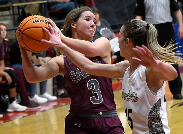 Kingfisher's Ally Stephenson pressures Garber's Kathryn Plunkett during the semi finals of the Wheat Capital Tournament Friday, January 8, 2021 at Chisholm High School. (Billy Hefton / Enid News & Eagle)