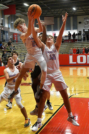 Chisholm's Hunter Combs grabs a rebound away from team mate, Luke Balenti and Alva's Braden Hofen during the first round of the Wheat Capital Tournament Thursday, January 7, 2021 at Chisholm High School. (Billy Hefton / Enid News & Eagle)