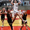 Kingfisher's Bijan Cortes goes up for a shot between Tecumseh's Jose Lugo and Brady Overstreet during the semi finals of the Wheat Capital Tournament Friday, January 8, 2021 at Chisholm High School. (Billy Hefton / Enid News & Eagle)