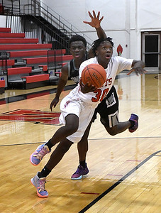 NOC Enid's Tydarius Fish gets around On Point Academy's Abou Wage for a shot Friday, January 22, 2021 Center at the NOC Mabee Center. (Billy Hefton / Enid News & Eagle)