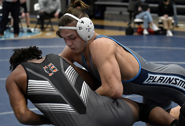 Enid's Chance Davis takes down Norman's Zain Prater-Nighswonger during their 170 pound match Tuesday, Jnauary 5, 2021 at Enid High School. (Billy Hefton / Enid News & Eagle)