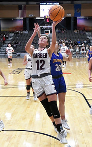 Garber's Ashlan Light gets pass Drummond's Kate Spring for a basket during the championship game of the 97th Skeltur Conference Basketball Tournament Saturday, January 23, 2021 at the Stride Bank Center. (Billy Hefton / Enid News & Eagle)
