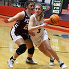 Kingfisher's Emily Myers drives around Perry's Savannah Chenowith during the championship game of the Wheat Capital Tournament Saturday, January 9, 2021 at Chisholm High School. (Billy Hefton / Endi News & Eagle)