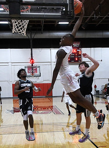 NOC Enid's Ikenna Okeke goes up for a dunk against On Point Academy Friday, January 22, 2021 Center at the NOC Mabee Center. (Billy Hefton / Enid News & Eagle)