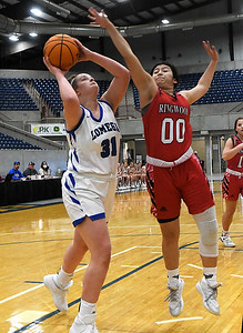 Lomega's Sydni Walker puts up a shot against Ringwood's Ana Resandiz during a semi-final gmae of the Cherokee Strip Conference Tournament Friday, January 22, 2021 at the Chisholm Trail Expo Center. (Billy Hefton / Enid News & Eagle)