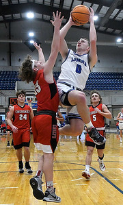 Lomega's Riley Lumpkin shoots over Cherokee's Ruston James during a semi-final gmae of the Cherokee Strip Conference Tournament Friday, January 22, 2021 at the Chisholm Trail Expo Center. (Billy Hefton / Enid News & Eagle)