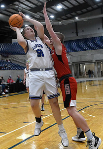 Lomega's Kelby Ott shoots over Cherokee's Treavor Green during a semi-final gmae of the Cherokee Strip Conference Tournament Friday, January 22, 2021 at the Chisholm Trail Expo Center. (Billy Hefton / Enid News & Eagle)