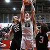 Kingfisher's Matthew Stone puts up a shot against OKC Knights's Sam Floyd and Connor Swanson during the championship game of the Wheat Capital Tournament Saturday, January 9, 2021 at Chisholm High School. (Billy Hefton / Endi News & Eagle)