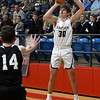 Kingfisher's Maverick Ridenour puts up a thres point shot against OKC Knights during the championship game of the Wheat Capital Tournament Saturday, January 9, 2021 at Chisholm High School. (Billy Hefton / Endi News & Eagle)