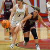Kingfisher's Emily Myers steals the ball from Garber's Kathryn Plunkett during the semi finals of the Wheat Capital Tournament Friday, January 8, 2021 at Chisholm High School. (Billy Hefton / Enid News & Eagle)