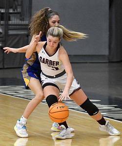 Garber's Katelyn Plunkett dribbles towards the basket while under pressure from Drummond's Brinley Buchanan during the championship game of the 97th Skeltur Conference Basketball Tournament Saturday, January 23, 2021 at the Stride Bank Center. (Billy Hefton / Enid News & Eagle)