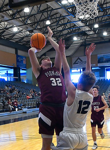 Pioneer's Kolby Vestal scores scores over Pond Creek-Hunter's Cole Svob during the opening round of the 97th Skeltur Conference Basketball Tournament Thursday, January 21, 2021 at the Stride Bank Center. (Billy Hefton / Endi News & Eagle)