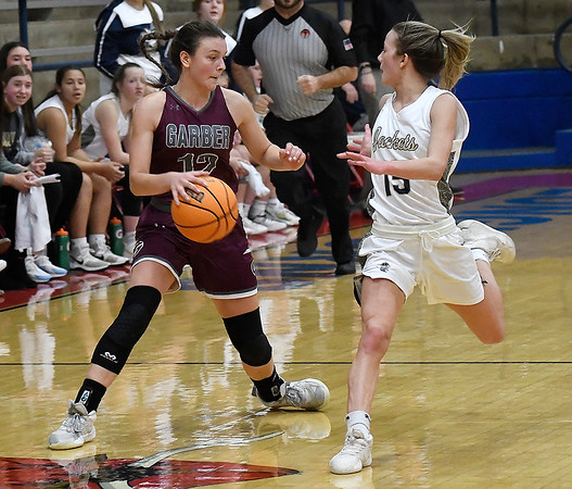Garber's Ashian Light dribble upcourt against pressure from Kingfisher's Ally Stephenson during the semi finals of the Wheat Capital Tournament Friday, January 8, 2021 at Chisholm High School. (Billy Hefton / Enid News & Eagle)