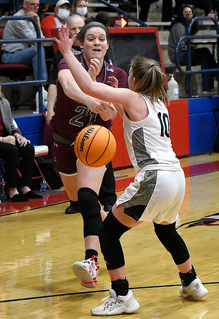 Garber's Sierra Martin passes the ball around Kingfisher's Peyton Walker during the semi finals of the Wheat Capital Tournament Friday, January 8, 2021 at Chisholm High School. (Billy Hefton / Enid News & Eagle)
