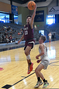 Pioneer's Ayden Iverson puts up a shot against Pond Creek-Hunter's Cole Svob during the opening round of the 97th Skeltur Conference Basketball Tournament Thursday, January 21, 2021 at the Stride Bank Center. (Billy Hefton / Endi News & Eagle)