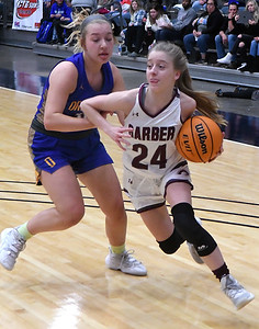 Garber's Alyssa Johnson gets pass Drummond's Emma Spring during the championship game of the 97th Skeltur Conference Basketball Tournament Saturday, January 23, 2021 at the Stride Bank Center. (Billy Hefton / Enid News & Eagle)