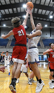 Lomega's Dilon Fisher gets a shot over Cherokee's Gabe Wyatt during a semi-final gmae of the Cherokee Strip Conference Tournament Friday, January 22, 2021 at the Chisholm Trail Expo Center. (Billy Hefton / Enid News & Eagle)