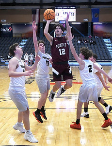 Pioneer's Ty Parker puts up a shot while surrounded by Pond Creek-Hunter defenders during the opening round of the 97th Skeltur Conference Basketball Tournament Thursday, January 21, 2021 at the Stride Bank Center. (Billy Hefton / Endi News & Eagle)