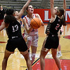 Chisholm's Courtney Petersen puts up a shot between Woodward's Ava Long and Thessaly Pfeifer during the first round of the Wheat Capital Tournament Thursday, January 7, 2021 at Chisholm High School. (Billy Hefton / Enid News & Eagle)