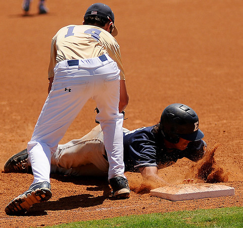 Enid Minors' Hunter Childs dives back to first as Southmoore attempts a tag during the Connie Mack State Baseball Tournament at David Allen Memorial Ballpark Friday, July 19, 2013. (Staff Photo by BONNIE VCULEK)