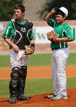 Leedey RBI's pitcher, Christopher Goldston, discusses a Chisholm batter with his catcher during a brief break in the action at the Red Dirt State Tournament at David Allen Memorial Ballpark Saturday, July 7, 2013. (Staff Photo by BONNIE VCULEK)