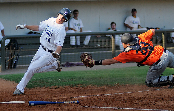 Enid Majors' Brandon Rakestraw eludes a tag by CC Boomers' Mikey Brenner at David Allen Memorial Ballpark Friday, July 12, 2013. (Staff Photo by BONNIE VCULEK)