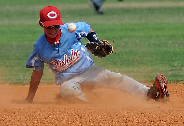 Chisholm's Scott Grebe sacrifices his body as he stops a single hit between first and second during a game against Leedey at the Red Dirt State Tournament at David Allen Memorial Ballpark Saturday, July 6, 2013. (Staff Photo by BONNIE VCULEK)