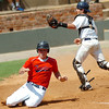 Woodward pinch runner, Thomas Sander, slides across home plate pass Enid catcher, Cross Bay, with the winning run in the bottom of the 7th inning Thursday during the opening round of the Connie Mack State Tournament at David Allen Memorial Ballpark in Enid. (Enid News & Eagle Photo by Billy Hefton)