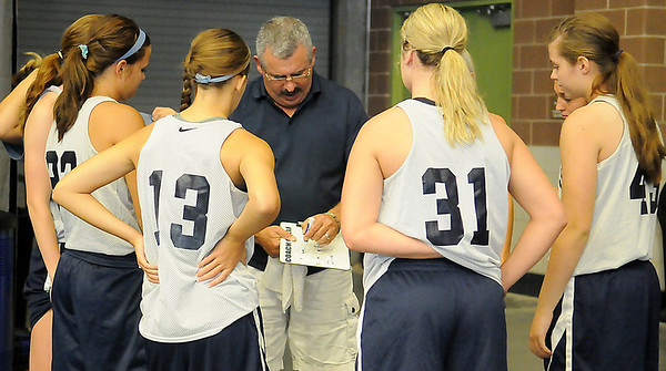 Randy Chelf goes over a play with the Enid Pacers before their game during the MAYB Basketball Tournament at the Enid Event Center Friday, July 19, 2013. (Staff Photo by BONNIE VCULEK)