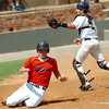 Woodward pinch runner, Thomas Sander, slides across home plate pass Enid catcher, Cross Bay, with the winning run in the bottom of the 7th inning Thursday during the opening round of the Connie Mack State Tournament at David Allen Memorial Ballpark. (Staff Photo by BILLY HEFTON)