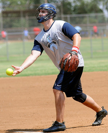 Akin 2 Live's Brock Gruenberg pitches to a Suit Up batter during the ASA Men's District Softball state qualifier at Kellet Ballpark Saturday, July 13, 2013. (Staff Photo by BONNIE VCULEK)