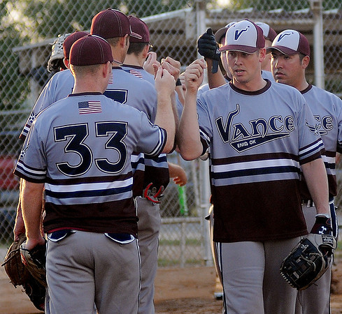 Vance AFB Airmen congratulate each other after blanking an opponent at Kellet Ballpark Tuesday, July 30, 2013. The team will compete during the Class B State Softball Tournament at Kellet Ballpark this Saturday. (Staff Photo by BONNIE VCULEK)
