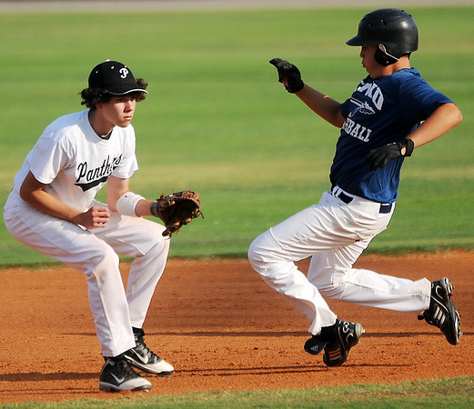 Enid Mickey Mantle Rookies' Austin Whitehead steals second against a Pond Creek Panther during the Red Dirt State Tournament at David Allen Memorial Ballpark Friday, July 5, 2013. (Staff Photo by BONNIE VCULEK)