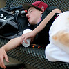 Vici Indians' Kaydan Whetstone pauses for a brief siesta during games at the Red Dirt State Baseball Tournament at David Allen Memorial Ballpark Saturday, July 6, 2013. (Staff Photo by BONNIE VCULEK)