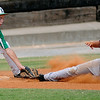 Leedey's Hank Harrel tags Chisholm's Bo Biggers out at third during the Red Dirt State Tournament at David Allen Memorial Ballpark Saturday, July 6, 2013. (Staff Photo by BONNIE VCULEK)