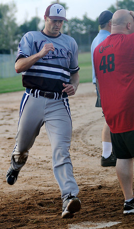 Vance AFB scores another run behind the opposing team's catcher Tuesday, July 30, 2013. Vance will play during the Class B state softball tournament at Kellett Ballpark this Saturday. (Staff Photo by BONNIE VCULEK)