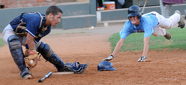 Enid Majors' Christian Voitik catches the ball as OKC Drillers' Jake Johnson dives and scores at David Allen Memorial Ballpark Saturday, July 13, 2013. (Staff Photo by BONNIE VCULEK)