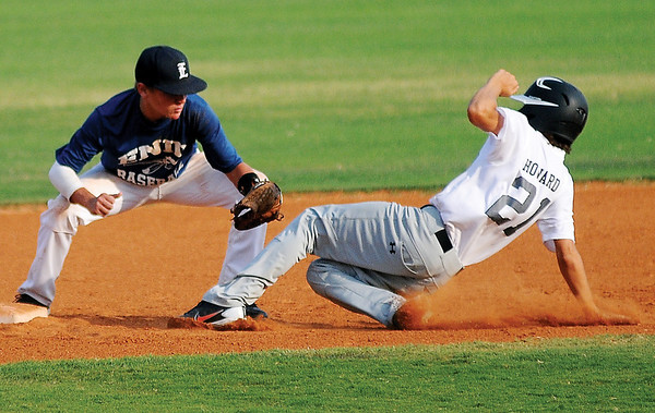 Enid Mickey Mantle Rookies' Kolton Felix tags out Pond Creek Panthers' Trey Howard out at second during the Red Dirt State Tournament at David Allen Memorial Ballpark Friday, July 5, 2013. (Staff Photo by BONNIE VCULEK)